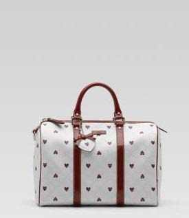 женские сумки Gucci.